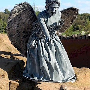 fallen angel human statue hire uk