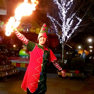 christmas elf fire performer