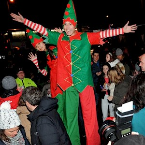 Christmas elf stilt walkers