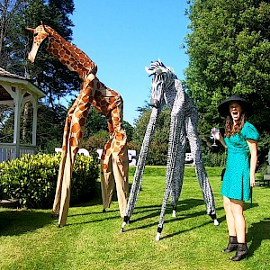 hire animal stilt walkers