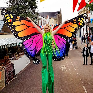 hire butterfly stilt walkers