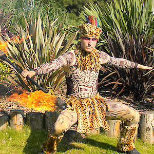 african safari themed fire performer