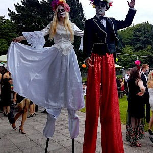 hire day of the dead stilt walkers